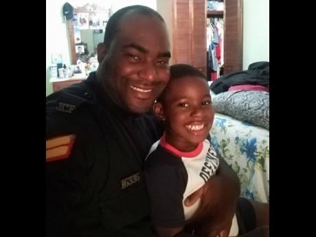 Policeman Winston Watson and his son.