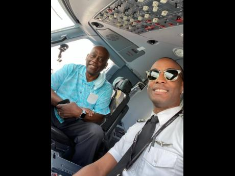 American Eagle Captain Anselm Dewar and his dad Ashman in the cockpit on a recent flight between Florida and South Carolina, United States.