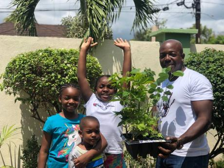Pearnel Charles Jr about to embark on an environmental project with his children, 11-year-old Pia-Elise, nine-year-old Eliana and five-year-old Pearnel James.
