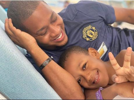 Floyd Green shares a moment with his son, Nathaniel Marcus.