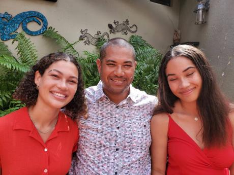 Mikael Phillips and his daughters, Isabel (left) and Gabriela.