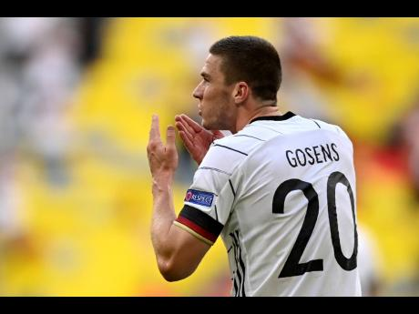 Germany's Robin Gosens celebrates after scoring his side's fourth goal during the Euro 2020 championship group F match between Portugal and Germany at the Football Arena stadium in Munich, Germany, yesterday. Germany won 4-2.