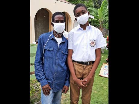 Scholarship recipient David Williams Jr (right), with his father David Williams Sr