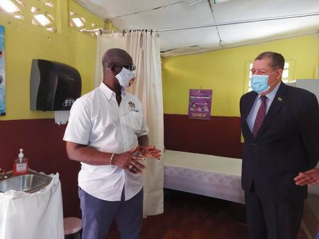 Minister of Local Government and Community  Development Desmond McKenzie (left), along with Member of Parliament for North East Manchester Audley Shaw visit the isolation area of the hurricane shelter at the Christiana Primary School last Friday.