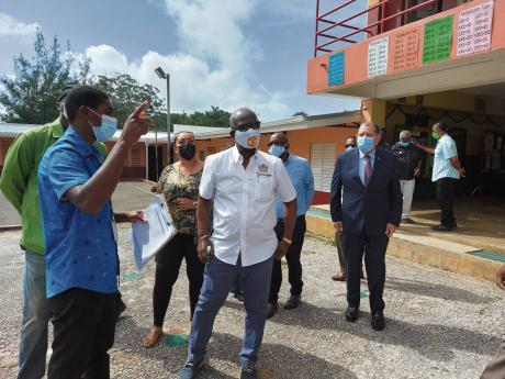 From left: Acting Parish Disaster Coordinator at the Manchester Municipal Corporation Keval Lewis, Minister of Local Government and Community Development Desmond McKenzie, and Member of Parliament for Manchester North East Audley Shaw, along with other off
