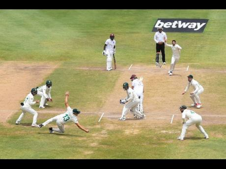South Africa's Keshav Maharaj (third right) claims his hat-trick with the dismissal of West Indies batsman Joshua Da Silva (fifth right) during day-four of their second and final Test match, played at the Daren Sammy National Stadium in Gros Islet, St Lu