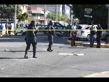 Left: Policemen cordon the intersection of North Street and South Camp Road, the site of a February 17 crash that killed one person and severely injured Trishauna Blair.
