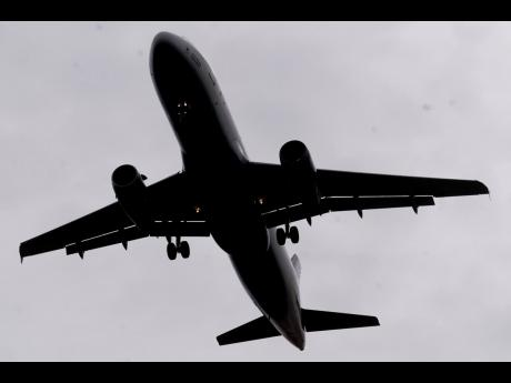 In this March 9, 2021 file photo, an airline arrives at Salt Lake City International Airport.