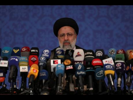Iran's new President-elect Ebrahim Raisi during a news conference in Tehran, Iran.