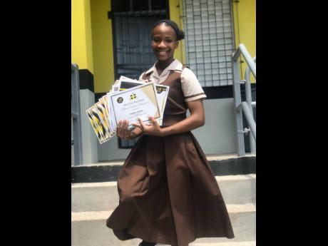 Yhannai Ferron displays her many awards received since entering high school.