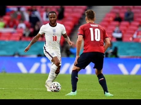 England's Raheem Sterling runs with the ball at Czech Republic's Patrik Schick (right) during the Euro 2020 championship group D match between the Czech Republic and England at Wembley stadium in London, yesterday. England won 1-0.