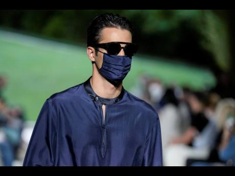 Armani closed the collection with more sombre silky looks and a handful of models wearing masks. These were no casual addition. The designer said, 'It means be careful', adding that he doesn't think the pandemic is over.
