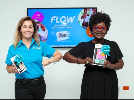 Sara Martins de Oliveira (left), senior marketing director, Flow Jamaica, shares an elbow greeting with Dr Renee Rattray, education consultant and co-founder of Science Genius Jamaica. Flow Jamaica has renewed its commitment to sponsor the staging of the S