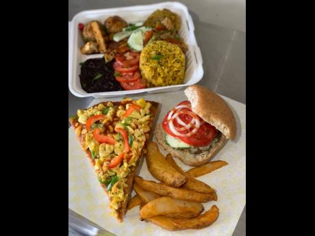 The Vegan Ackee Pizza, Cuban black bean stew and assorted treats, Maranatha Full House Burger and seasoned potato wedges.