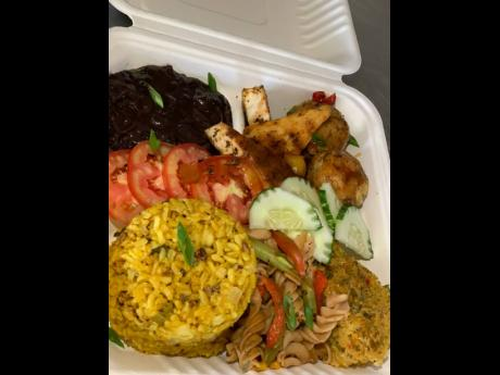 What's for lunch? How about Cuban black bean stew, pan grilled tofu served with sweet and sour sauce, chickpeas meatball, served with sweet and sour sauce, vegan Spanish rice, stir fried garlic pasta salad and organic vegan corn pie.
