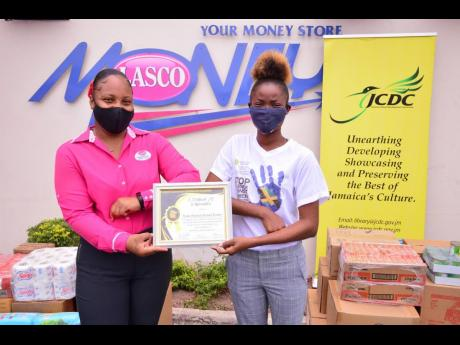 Lishaun Roberts, public relations officer of the Linstead Community Development Committee youth arm (right), proudly shares a photo with Nikeisha Alexander, sponsorship and promotions coordinator at LASCO Financials Services, after presenting to her a cert