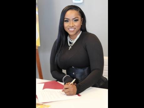 Yanique 'Curvy Diva' Barrett signs off on the publishing deal for her first cookbook, 'Dining With Curvy – From My Table To Yours'.