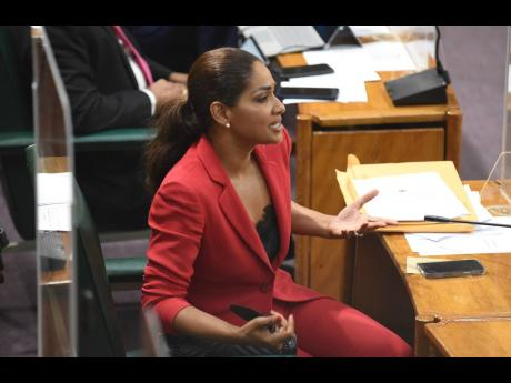 Madam Speaker, we'd like a full look at Lisa Hanna's red power suit which she softened with a black camisole, with a lace trimming.