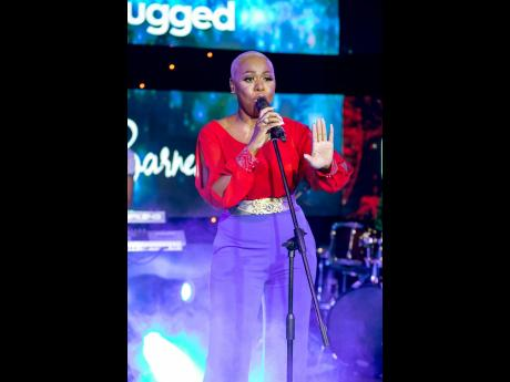 Bald-headed and beautiful, gospel singer and former 'Digicel Rising Stars' finalist Nickeisha Barnes captivated the audience. Wearing a red split sleeve shirt and violet pants. Barnes gave a powerful and inspirational performance at the Digicel Unplugg