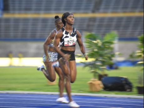 Shelly-Ann Fraser-Pryce competes in the women's 100m heats at the Jamaica Athletics Administrative Association's National Senior Championships at the National Stadium, last night.