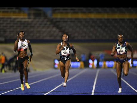 Shelly-Ann Fraser-Pryce (centre) storms away from runner-up Shericka Jackson (left) and third placed Elaine Thompson Herah to win the women's 100m final at the National Senior Championships at the National Stadium on Friday.