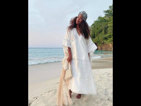 Kelly Rowland's caftan and turban is peak resort wear.
