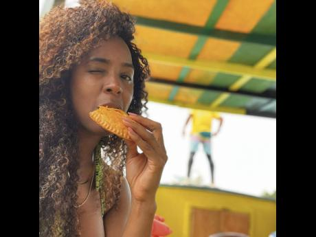 Rowland 'bigged up' Juici Patties in Ocho Rios. 'Missing Jamaica. Juici Patties in OCHIE got me,' she captioned a video and this snap.