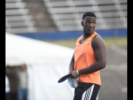 Ralford Mullings competing in the Under-20 boys discus throw at the JAAA National Senior and Junior Championships at the National Stadium  yesterday. Mullings won the event with a throw of 66.61 metres.