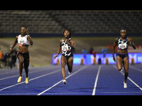 Shelly-Ann Fraser-Pryce (centre) wins the women's 100 metres in 10.71 seconds during the JAAA National Senior and Junior Championships at the National Stadium last night. Shericka Jackson (left) was second in 10.82 while third went to defending champion