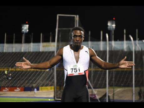 Tyquendo Tracey celebrates his win in the  men's 100 metres,  ahead of Yohan Blake (second) and Oblique Seville, at the JAAA National Senior and Junior Championships at the National Stadium last night. Tracey won the event in 10.00 seconds.