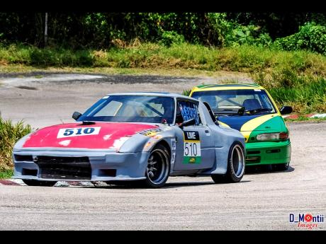 Veteran racer and car builder Neil Harvey in his beloved RX7 a.k.a Ole Roach.