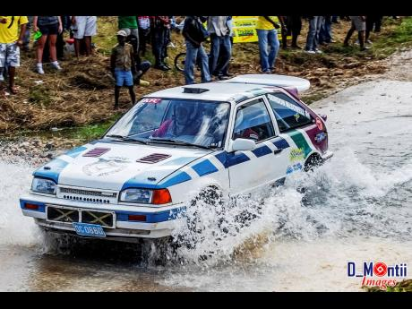 The McDowell brothers in their classic Mazda 324 GTX rally car, at the famous Bogwalk watersplash.The McDowell brothers in their classic Mazda 324 GTX rally car, at the famous Bogwalk watersplash.