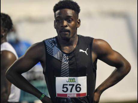 Michael Campbell catches his breath after competing in the men's 100m semi-finals at the National Senior Championships at the National Stadium on Friday, June 25, 2021.
