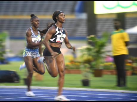 Shelly-Ann Fraser-Pryce competes in the 100m at the National Senior Championships at the National Stadium on Friday, June 25, 2021.