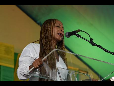 Reggae songbird Nadine Sutherland, who taught Justin Wallace at Challenge Preparatory Charter School, sang 'Pair of Wings' at the funeral.