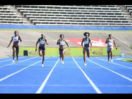 Fraser-Pryce (centre) leaves the rest of the field behind to win the women's 200m final. Also pictured are runner-up Shericka Jackson (left), third-place Elaine Thompson Herah (second left), fifth-place Ashanti Moore (second right), and seventh-place Kev
