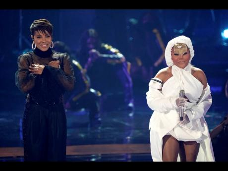 MC Lyte (left) and Lil' Kim perform 'UNITY' during a tribute to Queen Latifah at the BET Awards.