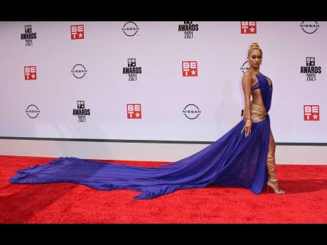 Saweetie arrives at the BET Awards on Sunday.