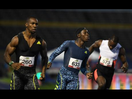 Oblique Seville (centre) competing in the men's 100m at the National Senior Championships at the National Stadium on June 25, 2021, against Yohan Blake (left) and Ramone Barnswell.