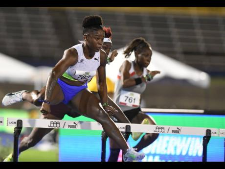 Britany Anderson competes in the semi-finals of the women's 100m hurdles event at the National Senior Championships at The National Stadium on Saturday, June 26, 2021.