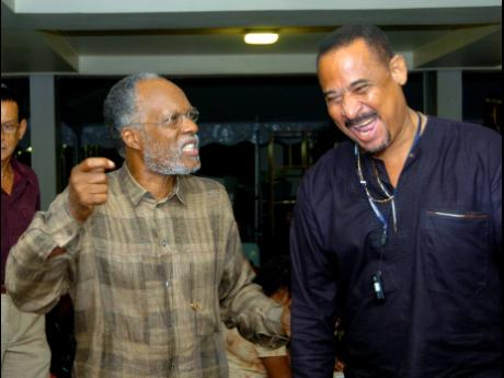 Orville 'Bagga' Case (right), shares a laugh with Herbie Miller in this 2007 file photograph.