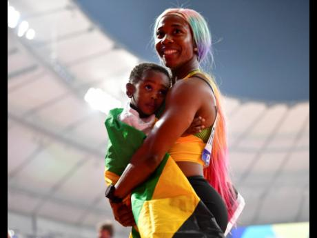 Fraser-Pryce and son, Zion, at the World Championships in 2019.