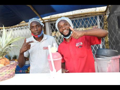 It's all about the positive energy for Central Smoothie boss Lenard Christie and Mark Farr (left).