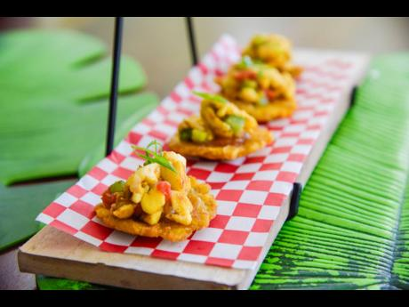 Ackee and mango chutney perfectly placed on a bed of tostones. That's the magic of Ackee Backee.