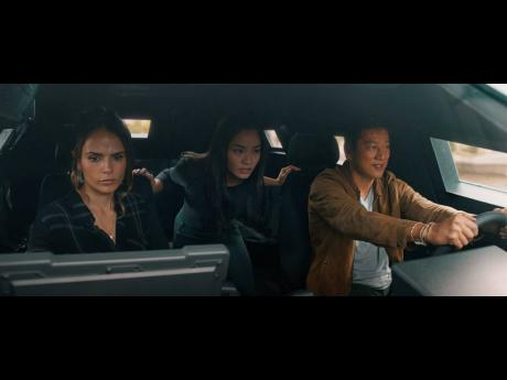 TOP: This 'F9: The Fast Saga' image released by Universal Pictures shows (from left) Jordana Brewster, Anna Sawai and Sung Kang.
