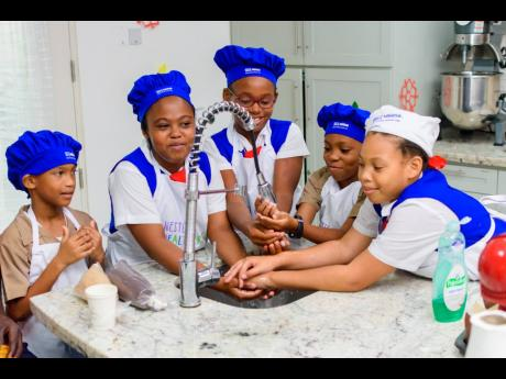 Students of the Lannaman's Preparatory School, a Nestle For Healthier Kids (N4HK) participating school, demonstrates one of the N4HK healthy habits: washing of hands.
