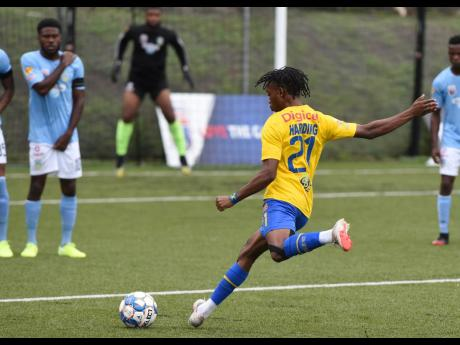 Harbour View's Odorland Harding takes a direct free kick during the Jamaica Premier League match held at the UWI Captain Horace Burrell Centre of Excellence on Monday. The game ended in a 1-1 draw.