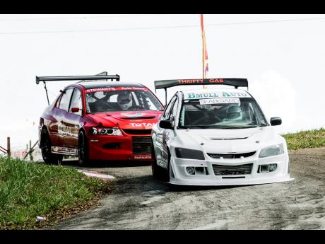 Charles Chen trying to stay ahead of a hounding David Summerbell Jr through the chicane at a past Dover race meet.