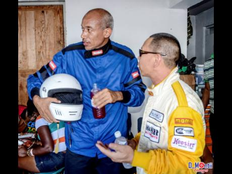Veteran racer Charles Chen getting a word of advice from International racer Roger Foo.