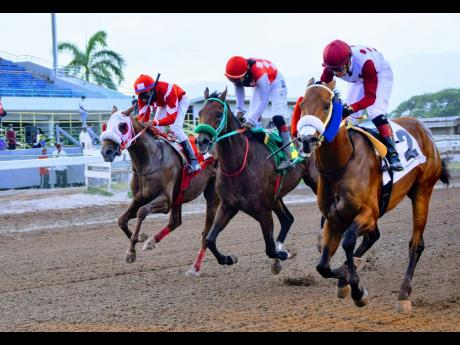 EAGLE ONE (right) ridden by Dick Cardenas wins the Labour Day trophy ahead of ANOTHER BULLET (Robert Halledeen) and the late rushing EXCESSIVE FORCE (Oshane Nugent) over 7 furlongs on the eight-race card at Caymanas Park on Tuesday, May 25, 2021.